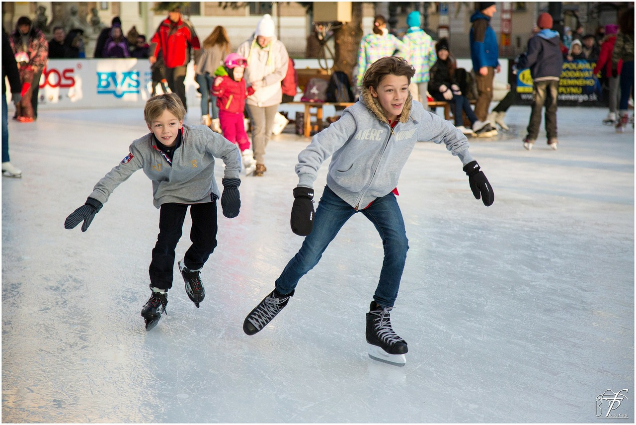 Young boys ice skating