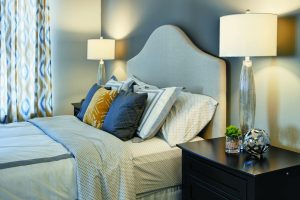 A bed in a bedroom at The Yards at Fieldside Village apartments.
