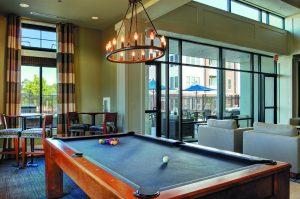 A pool table in the game room at The Yards at Fieldside Village apartments.