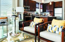 Two chairs in the seating area of the lobby at The Yards at Fieldside Village apartment community.