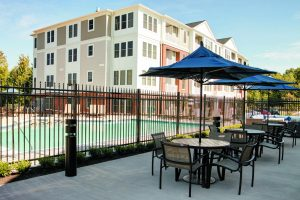 Outdoor seating near the saltwater pool at The Yards at Fieldside Village apartment community.