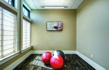 Yoga studio with three yoga balls at the fitness center at The Yards at Fieldside Village apartment community.